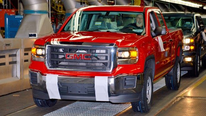 A 2014 GMC Sierra extended-cab pickup is driven off the final assembly line at Fort Wayne, Ind. GM put big discounts on extended-cab and crew-cab models with V-6s, which make up only a handful of sales.