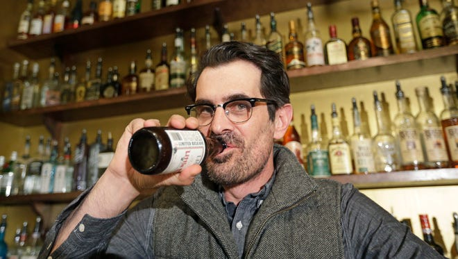 Actor Ty Burrell drinks a beer at Bar X, the cocktail bar he co-owns, in Salt Lake City.