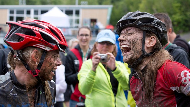 Team Ontario's Laura Bietola , right, burst into laughter after she won the silver medal behind gold medalist Frederique Trudel, left, of Team Quebec at the Canada games during a mountain bike event in August 2013 in Quebec.