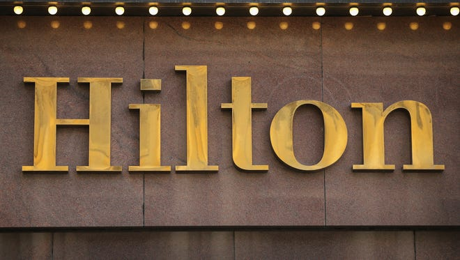 Hilton Worldwide is introducing new technology that will let guests check in and out, select exact rooms, and request amenities through their mobile devices, tablets, or computers. The company will also introduce keyless entry.