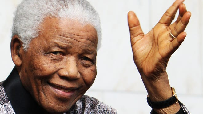 Former South African President Nelson Mandela, who died Thursday, at a photo shoot in advance of his 90th birthday celebration