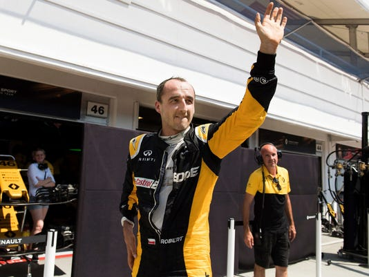FILE - This is a Wednesday, August 2, 2017 file photo of former Formula One driver Robert Kubica of Poland participates in a test session for Team Renault on the Hungaroring circuit in Mogyorod, 23 kms north-east of Budapest, Hungary. Sergey Sirotkin has been chosen ahead of Robert Kubica to drive for Williams in this year's Formula One championship. (Szilard Koszticsak/MTI File via AP)