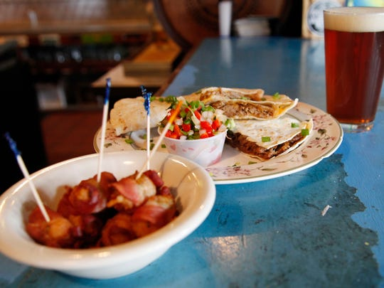 Bacon wrapped tater tots and the Philly style quesadilla from El Bait Shop on Aug. 29, 2014 in downtown Des Moines.