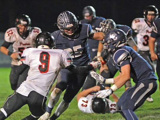 Senior Brandon Yeagy weaves his way downfield for Central Catholic against the Gophers Friday night.
