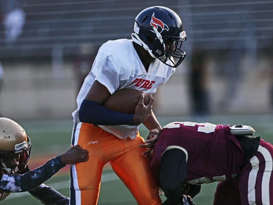 April 27, 2018 - Tevin Carter, 15, a rising freshman quarterback with Pure Youth, an organization that focuses on football, education, and character, plays in a scrimmage against Melrose High School at Melrose Stadium on Friday. At his young age, he's fielding offers from three major colleges.