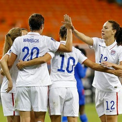 United States forward Abby Wambach (20) celebrates with teammates after scoring a goal against Haiti in the second half of a Women's World Cup Qualifier at RFK Stadium in Washington on Monday.