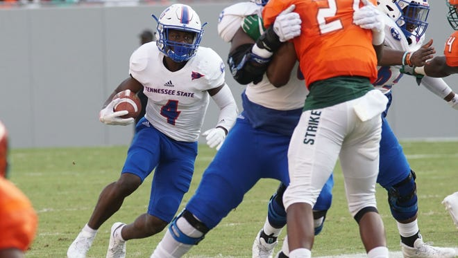 Tennessee State running back Sabre Curtis looks for running room against Florida State in the Tampa Classic.