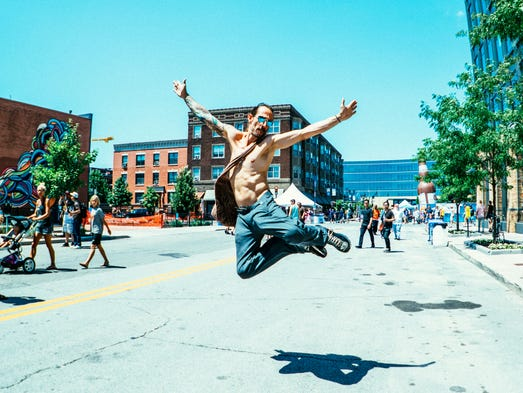 Jason Brommel, 38, of Des Moines, jumping for joy at
