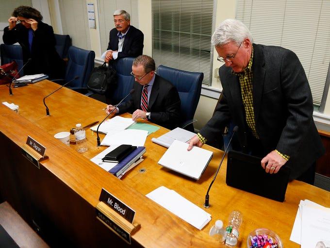 Deputy Mayor Rick Blood, r,  packs up his personal