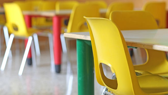 Classroom with yellow chairs and tables in the kindergarten