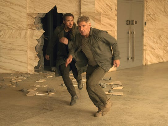 Ryan Gosling, left, and Harrison Ford in a scene from