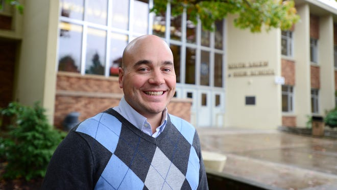 South Salem High School Lead Counselor Todd Bobeda is photographed in front of the school on Tuesday, Oct. 28, 2014.