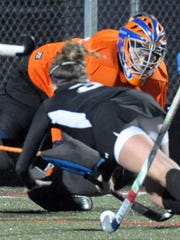 Delmar goalie Tressie Windsor defends against Sussex Tech's Darian Scott during a state field hockey tournament.
