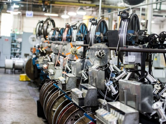 Wiring is processed inside the Belden Wire & Cable manufacturing facility in Richmond on Wednesday, May 23, 2018.