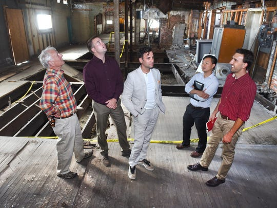 Peter Allen, left, Clarke Lewis, Douglas Lane Allen, Dang Duong and Myles Hamby are part of an investment group that owns 6408 Woodward and hope to close soon on 6402 Woodward.