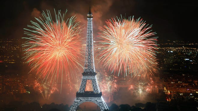 Fireworks illuminate the Eiffel Tower in Paris during Bastille Day celebration in 2011.