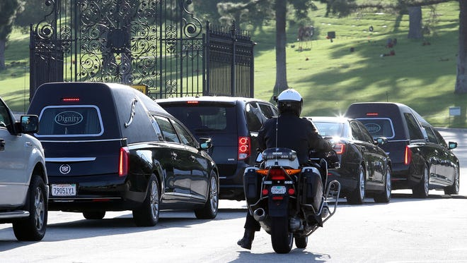 The funeral procession for Carrie Fisher and Debbie Reynolds makes its way to their gravesite at Forest Lawn Memorial Park in the Hollywood Hills Friday.