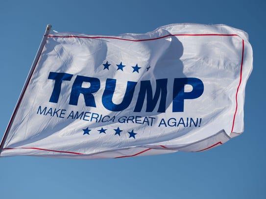 A Donald Trump campaign flag waves outside a Trump