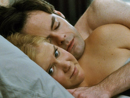 """Amy Schumer and Bill Hader appear in a scene from """"Trainwreck."""""""