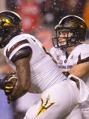 Oct. 17, 2015; Salt Lake City; Arizona State Sun Devils quarterback Mike Bercovici (2) hands off to running back Kalen Ballage (9) during the first half against the Utah Utes at Rice-Eccles Stadium.