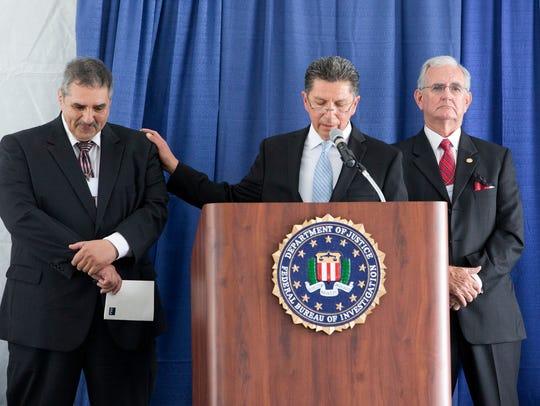 Retired FBI Special Agent Gilbert Orrantia, center,
