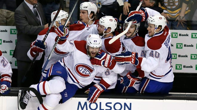 Montreal left wing Max Pacioretty leaps from the bench as teammates celebrate a 3-1 win over Boston in Game 7 of a second-round Stanley Cup playoff series on Wednesday night. The Canadiens advanced to the Eastern Conference finals against the New York Rangers.