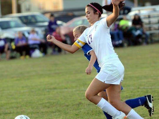 Portland High junior defender Ashley McIntosh battles