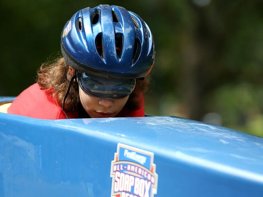 Ileiza Barnes, 12, of Salem, waits to start her race in the 20th Annual Soap Box Derby at Bush's Pasture Park on Saturday, May 23, 2015, in Salem, Ore.