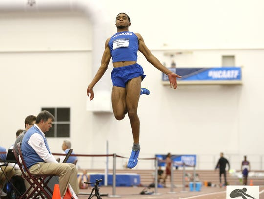 DeAndre Bates takes flight during the NCAA Indoor Track