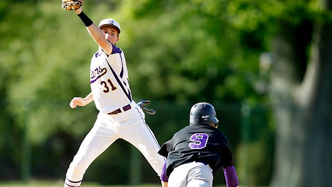 Clarkstown North shortstop Brian Kay (31) reaches for a throw as New Rochelle baserunner Jake Armiento (9) steals second base Class AA sectional outbracket baseball game at Clarkstown North in New City on Friday, May 20, 2016.  New Rochelle won 10-4.