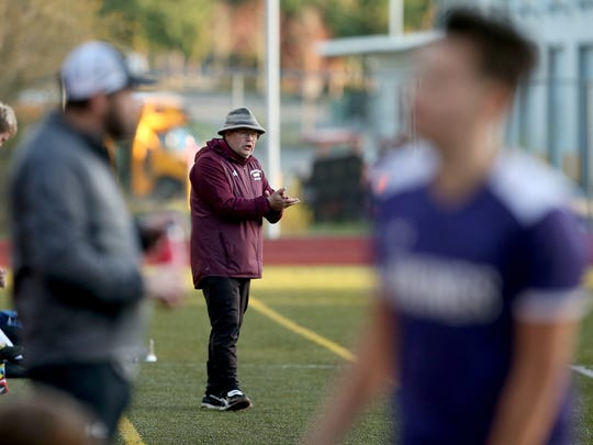 Kingston boys soccer coach Craig Smith said he and other high school coaches in the North Kitsap School District wouldn't get paid coaching stipends for the time they are missing due to coronavirus.