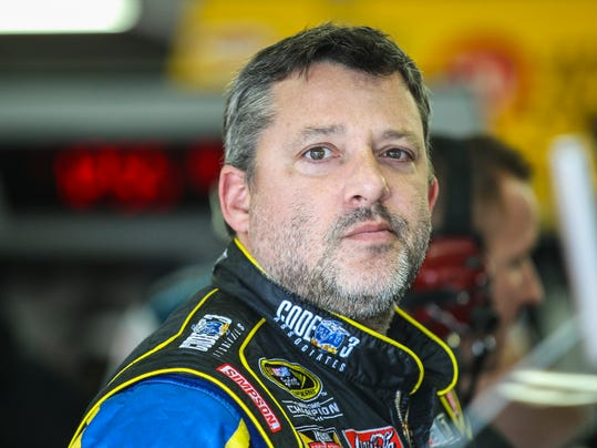 Driver Tony Stewart waits in the garage while his car is worked on during practice for the Sunday's NASCAR Sprint Cup series auto race at New Hampshire Motor Speedway in Loudon, N.H., Friday, Sept. 25, 2015  (AP Photo/Cheryl Senter)