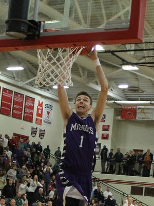 Jimmy Ratliff finishes off a fast-break with a dunk in the Middies' 54-49 win.