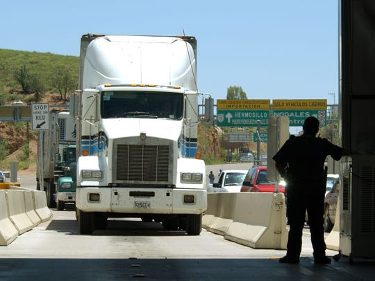 A U.S. Customs agent waits for a northbound truck crossing