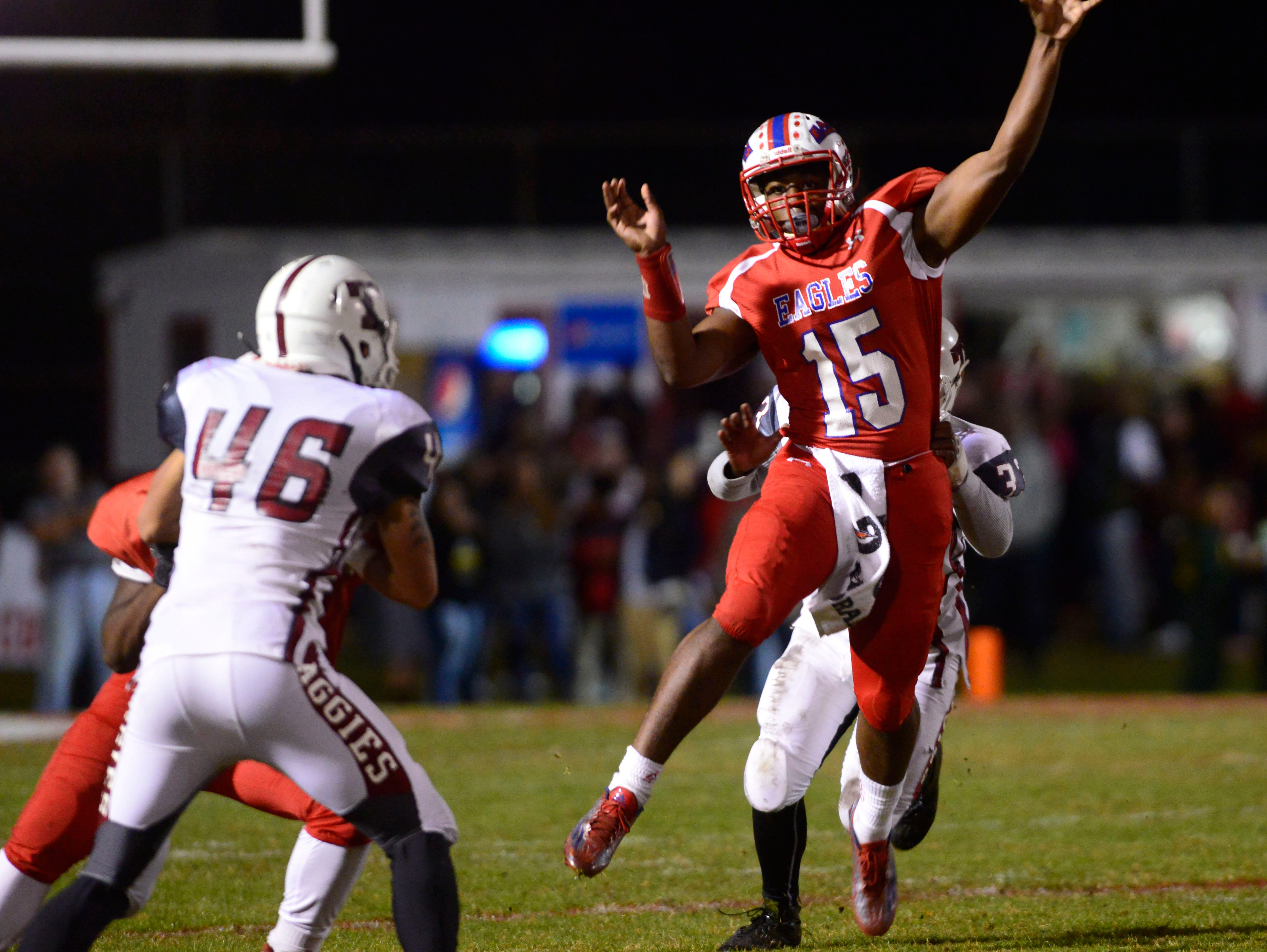 Pine Forest High School quarterback Xavier Saulsberry sends the ball to a receiver Friday night while taking on Tate High in the Region 1-6A final. Tate beat Pine Forest 31-7.