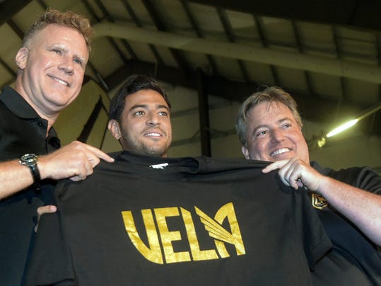 From left to right, actor Will Ferrell, Los Angeles FC designated player Carlos Vela and LAFC lead managing owner Larry Berg pose at an MLS soccer news conference in Los Angeles, Friday, Aug. 11, 2017. (Walt Mancini/Los Angeles Daily News via AP)