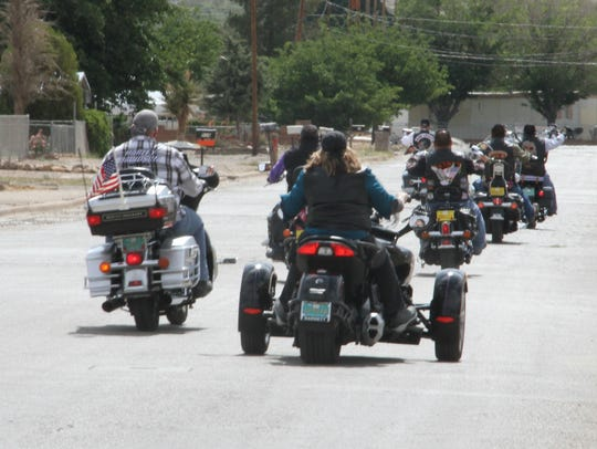 Motorcyclists travel down 24th Street Saturday on their