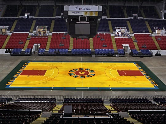 For one day only, the world's largest pop art painting, Robert Indiana's MECCA floor, will be assembled in its original form and exhibited in its original home, the old MECCA Arena (current U.S. Cellular Arena). Journal Sentinel photo by Rick Wood/RWOOD@JOURNALSENTINEL.COM  NOTE: NO VIDEO AS SHE HAD EVERYTHING ALREADY PREPARED TO SHOW WHEN WE ARRIVED.