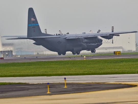 A Delaware Air National Guard C-130 takes off from the New Castle Air National Guard Base.