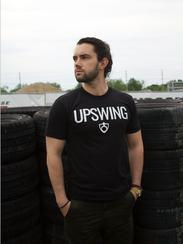 Austin Waldo models an Upswing-branded shirt. He'll