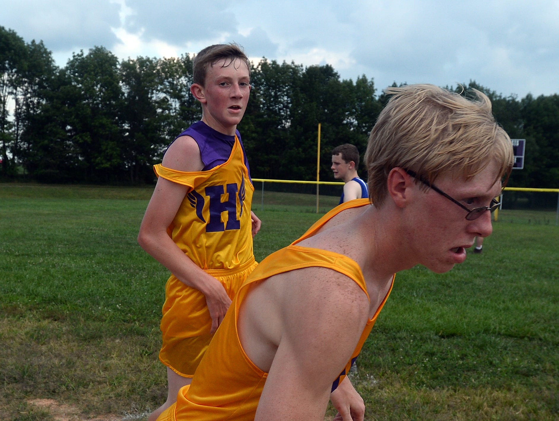 Hagerstown's Seth Richards, left, tags Lucas Artman for his leg.