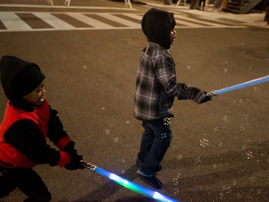 Desamuel King, 4, left, and his cousin TJ Sellers swing