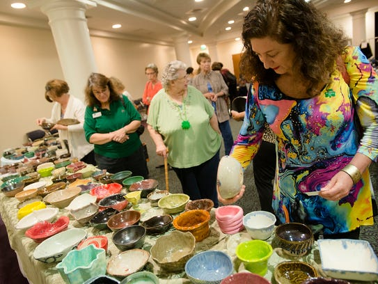 Donna Levine O'Connor looks at bowls during the annual