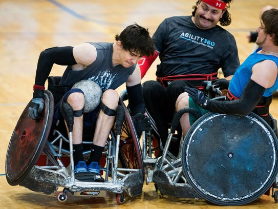 Jake Zunich (left) practices during an Ability360 Heat
