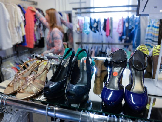 Shoes line a display as Brenda Halverson, Albany, looks