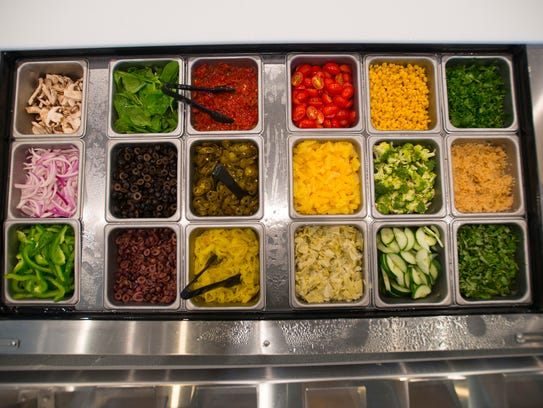 Different pizza and salad toppings at Pieology on Wednesday,
