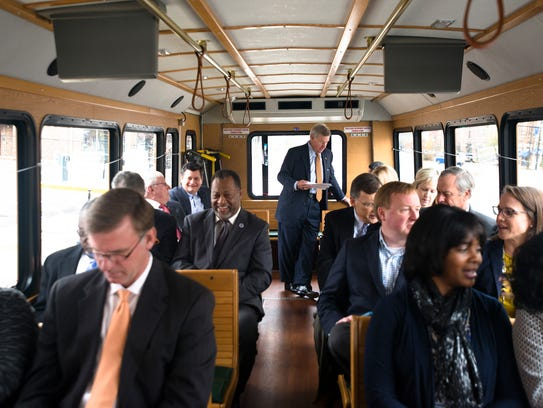 Mayor Todd Strange, center, rides with the Montgomery