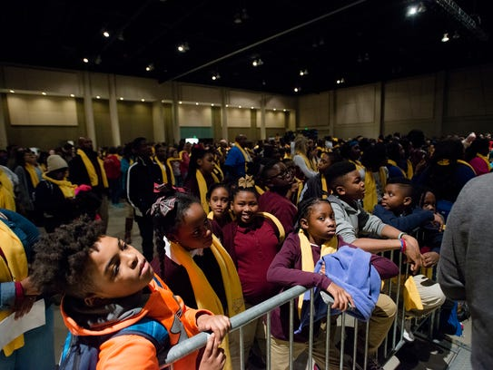 Students look on during an annual rally in support