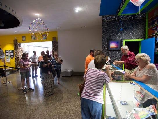 People line up at the W.A. Gayle Planetarium to buy