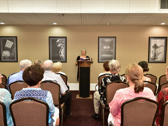 Andrea Walker reads an excerpt from her book to the